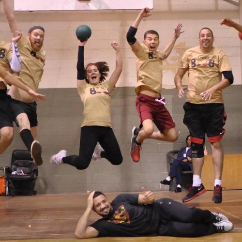 Dodgeball team jumping for picture
